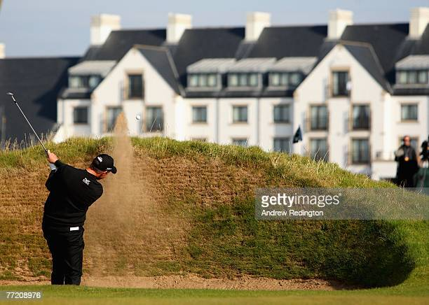 Soren Hansen of Denmark plays from a bunker on the 16th hole in front of the hotel during the third round of The Alfred Dunhill Links Championship at...