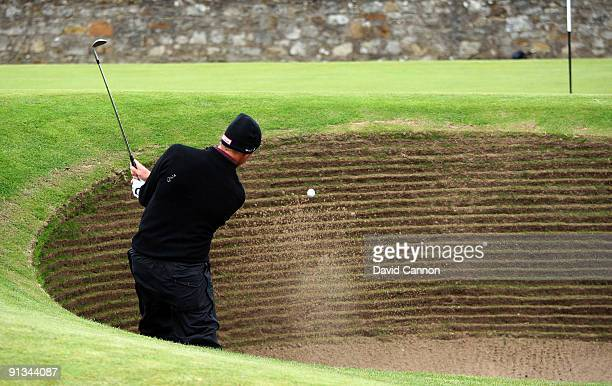 Soren Hansen of Denmark plays out of the bunker on the 17th green during the second round of The Alfred Dunhill Links Championship at The Old Course...