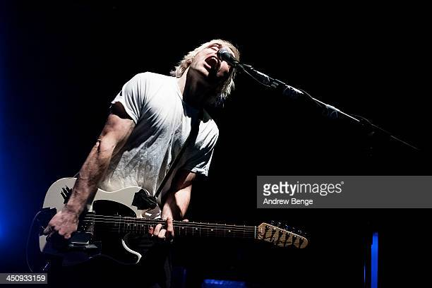 Soren Hansen of New Politics performs on stage at Manchester Arena on November 20 2013 in Manchester United Kingdom