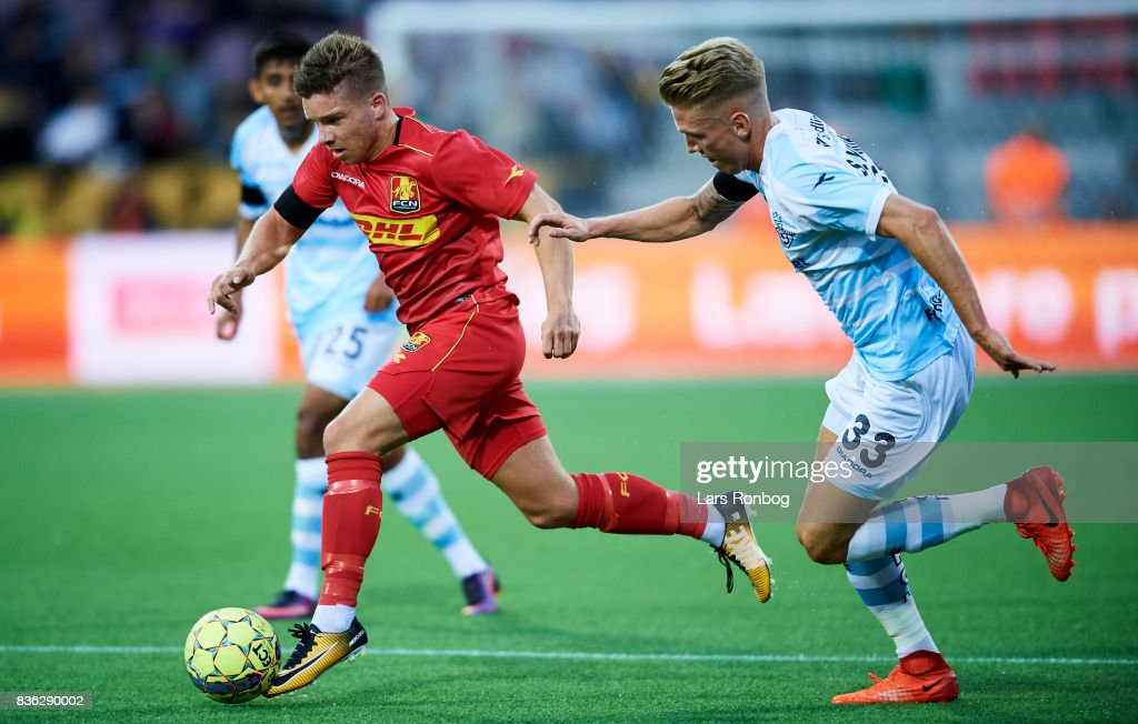 Soren Henriksen of FC Helsingor chasing Mads Pedersen of FC Nordsjalland during the Danish Alka Superliga match between FC Nordsjalland and FC Helsingor at Right to Dream Park on August 21, 2017 in Farum, Denmark.