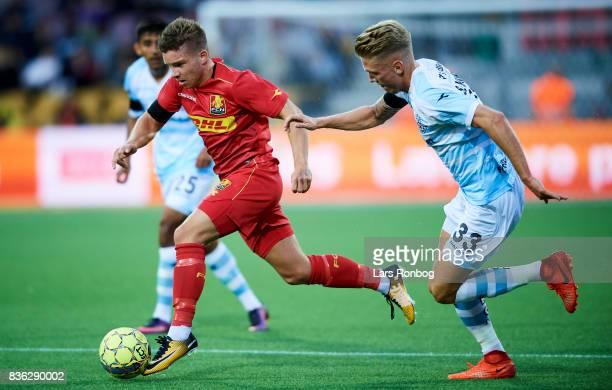 Soren Henriksen of FC Helsingor chasing Mads Pedersen of FC Nordsjalland during the Danish Alka Superliga match between FC Nordsjalland and FC...