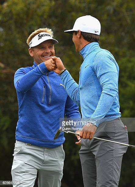 Soren Kjeldsen and Thorbjorn Olesen of Denmark celebrate a birdie during day two of the World Cup of Golf at Kingston Heath Golf Club on November 25...