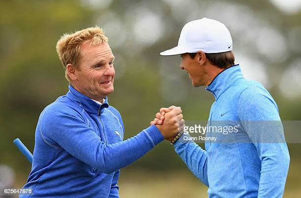 Soren Kjeldsen and Thorbjorn Olesen of Denmark shake hands after finishing on the 18th during day two of the World Cup of Golf at Kingston Heath Golf...
