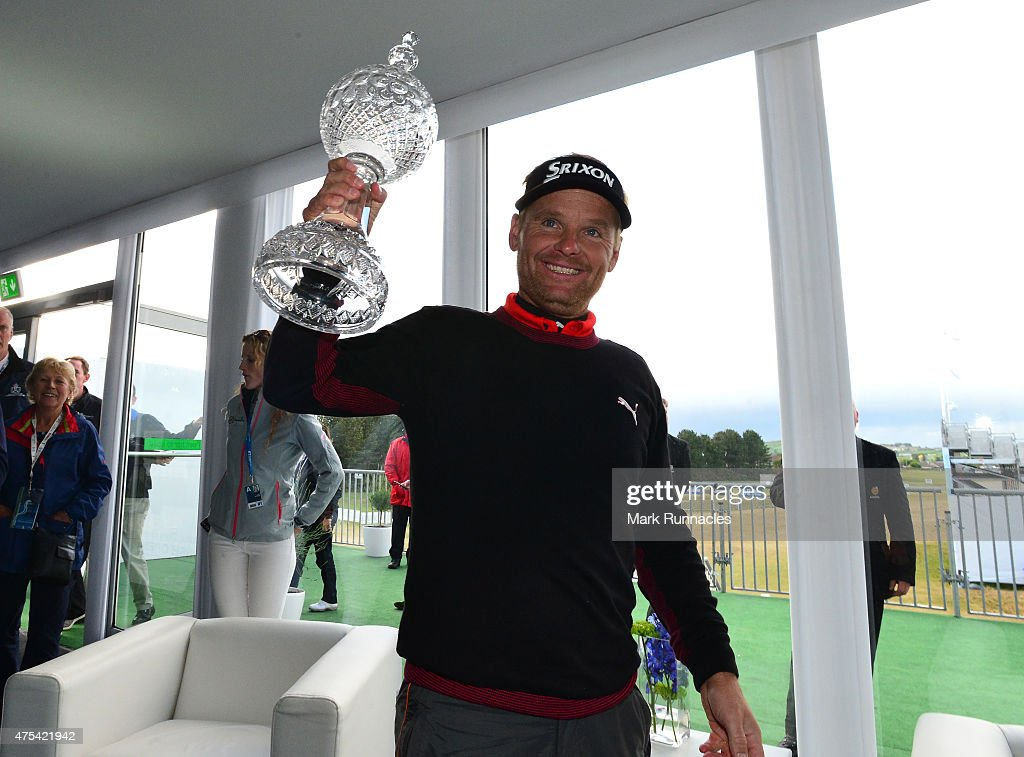 Soren Kjeldsen of Denmark celebrates winning the Dubai Duty Free Irish Open hosted by the Rory Foundation as he meets the marshall staff at Royal County Down Golf Club on May 31, 2015 in Newcastle, Northern Ireland.