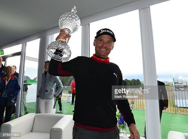 Soren Kjeldsen of Denmark celebrates winning the Dubai Duty Free Irish Open hosted by the Rory Foundation as he meets the marshall staff at Royal...