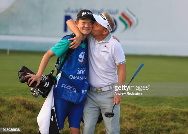 Soren Kjeldsen of Denmark gives his son and caddie Emil a kiss during the Pro Am prior to the start of the NBO Oman Open at Al Mouj Golf on February...