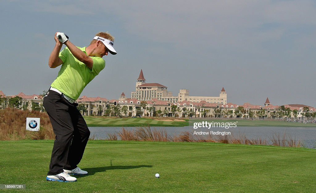 Soren Kjeldsen of Denmark hits his tee-shot on the ninth hole during the final round of the BMW Masters at Lake Malaren Golf Club on October 27, 2013 in Shanghai, China.
