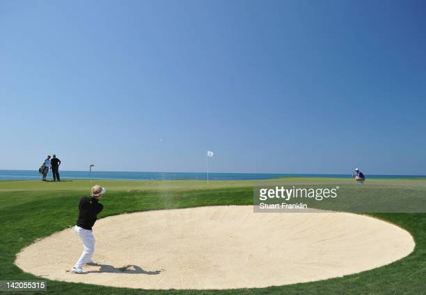 Soren Kjeldsen of Denmark plays a bunker shot during the first round of the Sicilian Open at Verdura Golf and Spa Resort on March 29 2012 in Sciacca...