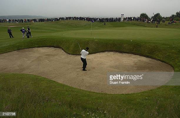 Soren Kjeldsen of Denmark plays from a bunker on the 16th hole during the final round at The Diageo Championships at the PGA Centenary course on June...