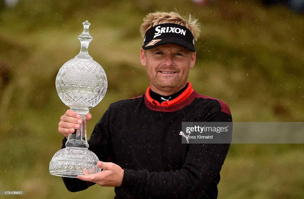 Soren Kjeldsen of Denmark poses with the trophy after his victory in a playoff during the Final Round of the Dubai Duty Free Irish Open Hosted by the Rory Foundation at Royal County Down Golf Club on May 31, 2015 in Newcastle, Northern Ireland.