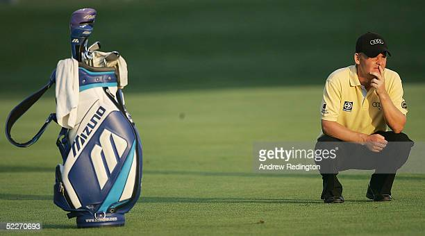 Soren Kjeldsen of Denmark waits to hit his second shot on the 18th hole during the first round of the Dubai Desert Classic at the Emirates Golf Club...