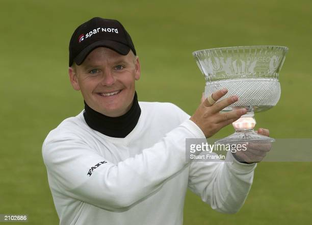 Soren Kjeldsen of Denmark with the trophy for winning the final round at The Diageo Championships at the PGA Centenary course on June 22 Gleneagles,...