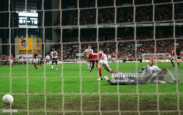 Soren Larsen of Denmark scores their fourth goal during the International Friendly match between Denmark and England at the Parken Stadium on August...