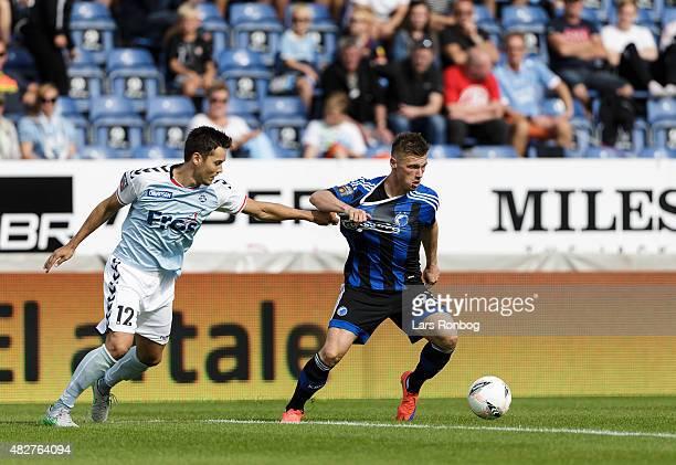 Soren Mussmann of Sonderjyske and Marvin Pourie of FC Copenhagen compete for the ball during the Danish Alka Superliga match between Sonderjyske and...