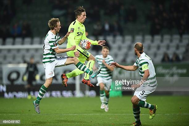 Soren Reese of Viborg FF and Nicki Bille Nielsen of Esbjerg fB compete for the ball during the Danish Alka Superliga match between Viborg FF and...