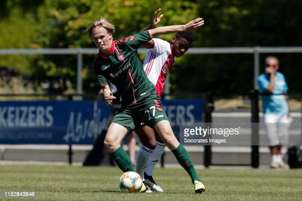 Soren Tengstedt of Aalborg BK, Jurrien Timber of Ajax during the match between Ajax v Aalborg on June 29, 2019 in Oldenzaal Netherlands
