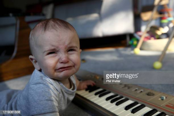 Soren Walter 6 months old and son of the photographer plays on a portable keyboard at home during the COVID19 isolation period on March 26 2020 in...