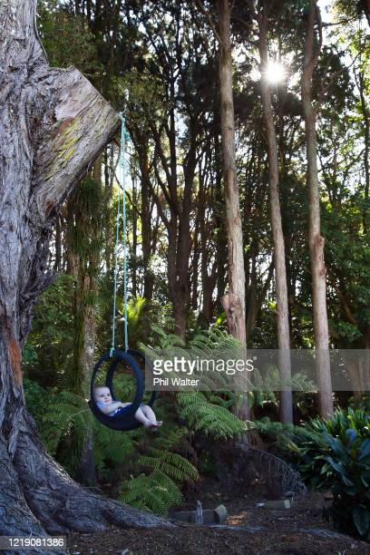 Soren Walter 6 months old and son of the photographer sits in a homemade swing in the photographers garden during the COVID19 isolation period on...