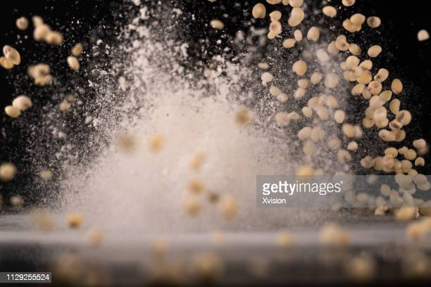 """sorghum""""n""""n seeds dancing captured with high speed sync""""n - sorghum stock pictures, royalty-free photos & images"""
