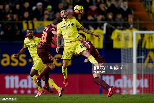 Soriano of Villarreal CF competes for the ball with Sergi Roberto of FC Barcelona during the La Liga game between Villarreal CF and FC Barcelona at...