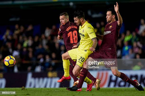 Soriano of Villarreal CF competes for the ball with Sergio Busquets and Jordi Alba of FC Barcelona during the La Liga game between Villarreal CF and...