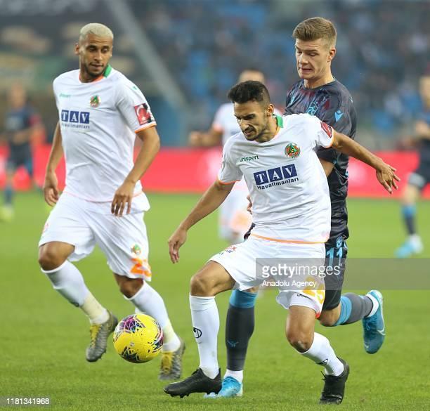 Sorloth of Trabzonspor in action against Onur Bulut of Aytemiz Alanyaspor during the Turkish Super Lig week 11 soccer match between Trabzonspor and...