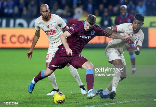 Sorloth of Trabzonspor in action against Ryan Donk and Marcao of Galatasaray during the Turkish Super Lig week 13 soccer match between Trabzonspor...