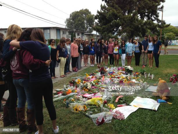 Sorority members gather at a makeshift memorial in front of Alpha Phi in Isla Vista California Two of their own were gunned down in a murderous...