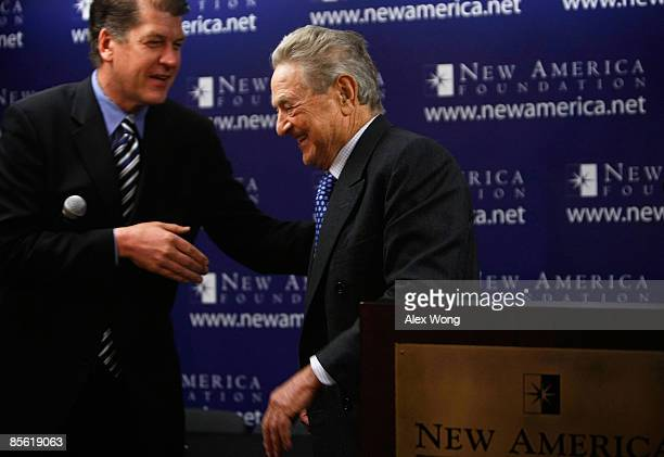 Soros Fund Management Chairman George Soros walks away from the podium after he spoke as American Strategy Program Director Steve Clemons looks on...