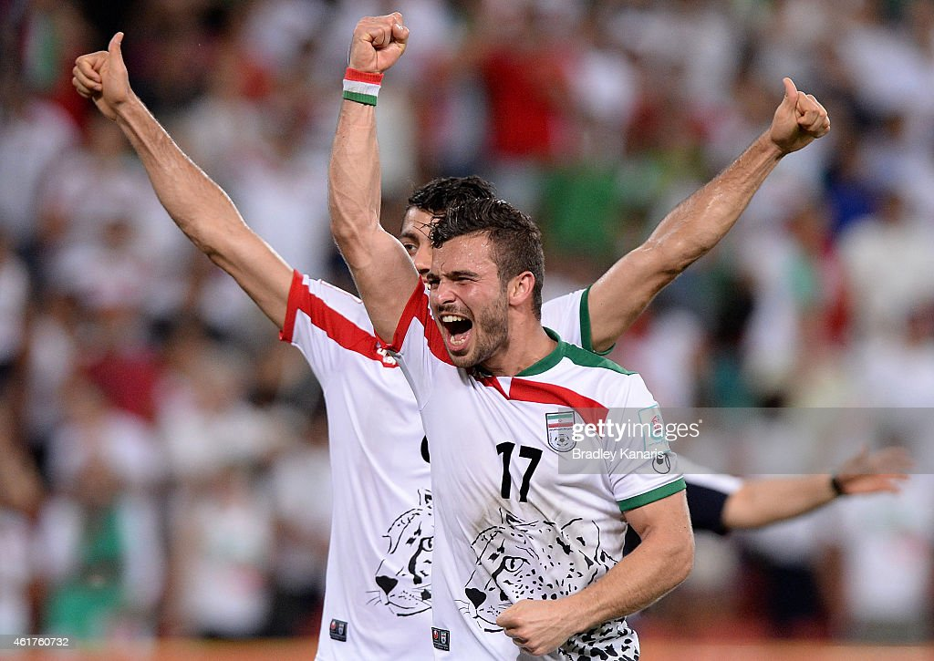 Soroush Rafiei and Morteza Pouraliganji of Iran celebrate their teams victory after the 2015 Asian Cup match between IR Iran and the UAE at Suncorp Stadium on January 19, 2015 in Brisbane, Australia.
