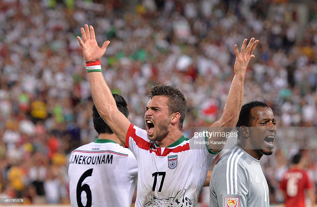 Soroush Rafiei of Iran celebrates a goal by team mate Reza Ghoochannejhad during the 2015 Asian Cup match between IR Iran and the UAE at Suncorp Stadium on January 19, 2015 in Brisbane, Australia.