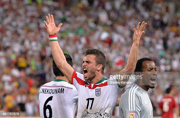 Soroush Rafiei of Iran celebrates a goal by team mate Reza Ghoochannejhad during the 2015 Asian Cup match between IR Iran and the UAE at Suncorp...