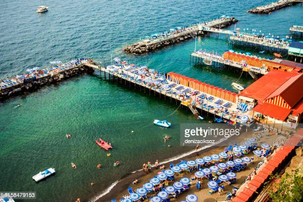 sorrento coast with bathing platforms, amalfi coast, italy - sorrento italy stock pictures, royalty-free photos & images