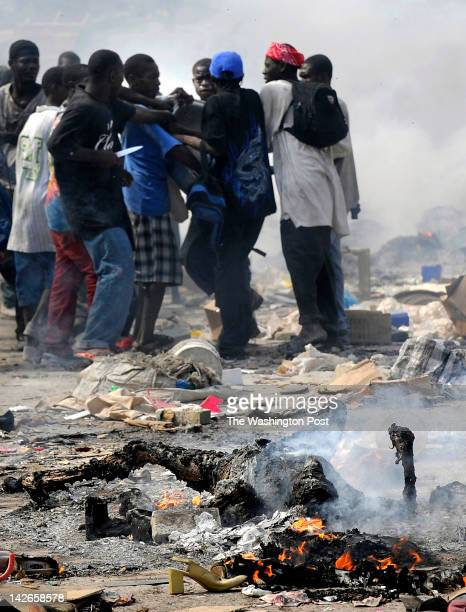 S PROFOUND SORROWBurn The smell of charred flesh lingers as Haitian survivors burn bodies and brandish knives while taking goods from stores in the...