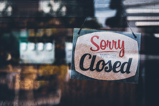 Sorry we're closed . grunge image hanging on a cafe window, Coronavirus COVID-19 outbreak lockdown. 1216744874