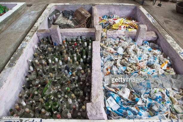 Sorted household waste sits in a warehouse at a recycling facility operated by Mysuru City Corp in Mysuru Karnataka India on Tuesday Nov 21 2017 The...
