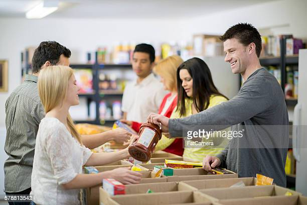 sorting food for donations - charity benefit stock pictures, royalty-free photos & images