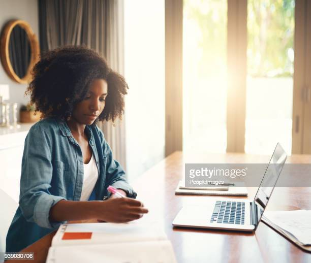 sorting out all her plans - afro stock pictures, royalty-free photos & images