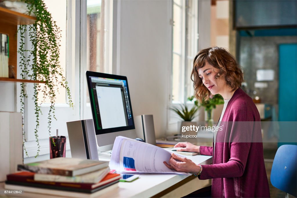 Sorting out some admin for her home-based business : Stock Photo