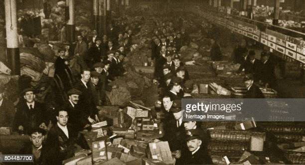 Sorting parcels at the Post Office Mount Pleasant London 20th century The largest sorting office operated by the Royal Mail Mount Pleasant Sorting...