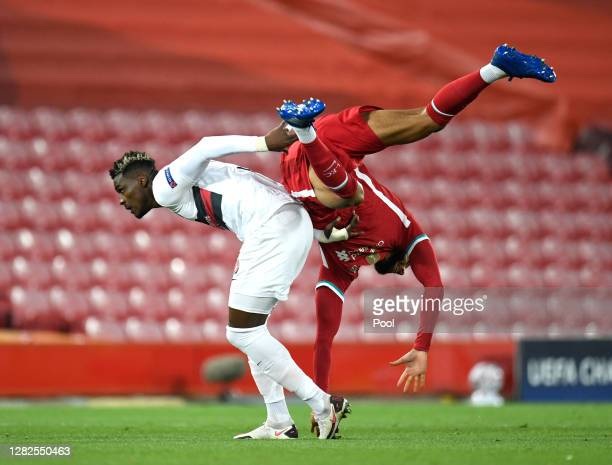 Sory Kaba of FC Midtjylland battles for possession with Joe Gomez of Liverpool during the UEFA Champions League Group D stage match between Liverpool...