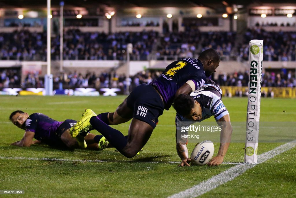 Sosaia Feki of the Sharks beats Suliasi Vunivalu of the Storm to score in the corner during the round 14 NRL match between the Cronulla Sharks and the Melbourne Storm at Southern Cross Group Stadium on June 8, 2017 in Sydney, Australia.