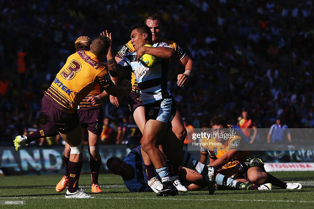 Sosaia Feki of the Sharks charges forward during the semi final match between the Brisbane Broncos and the Cronulla Sharks in the Auckland NRL Nines at Eden Park on February 16, 2014 in Auckland, New Zealand.