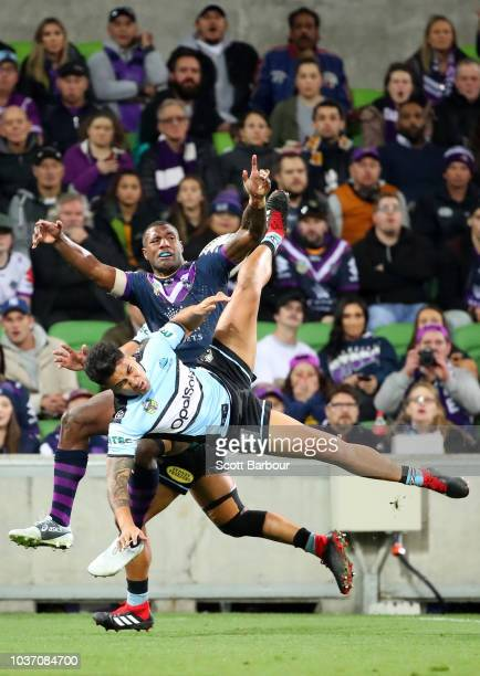 Sosaia Feki of the Sharks contests the ball with Suliasi Vunivalu of the Storm during the NRL Preliminary Final match between the Melbourne Storm and...