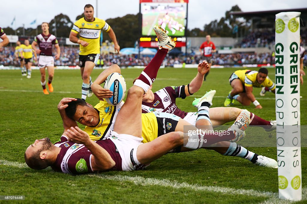 Sosaia Feki of the Sharks is held up in the corner by Brett Stewart of the Sea Eagles during the round 26 NRL match between the Cronulla Sharks and the Manly Sea Eagles at Remondis Stadium on September 6, 2015 in Sydney, Australia.