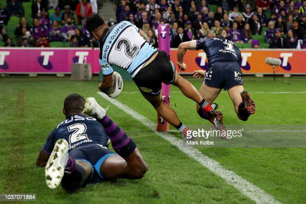Sosaia Feki of the Sharks is shoulder charged over the sideline by Billy Slater of the Storm during the NRL Preliminary Final match between the...