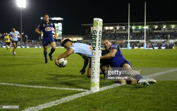 Sosaia Feki of the Sharks is tackled by Brenko Lee of the Bulldogs short of the try line during the round 12 NRL match between the Cronulla Sharks...