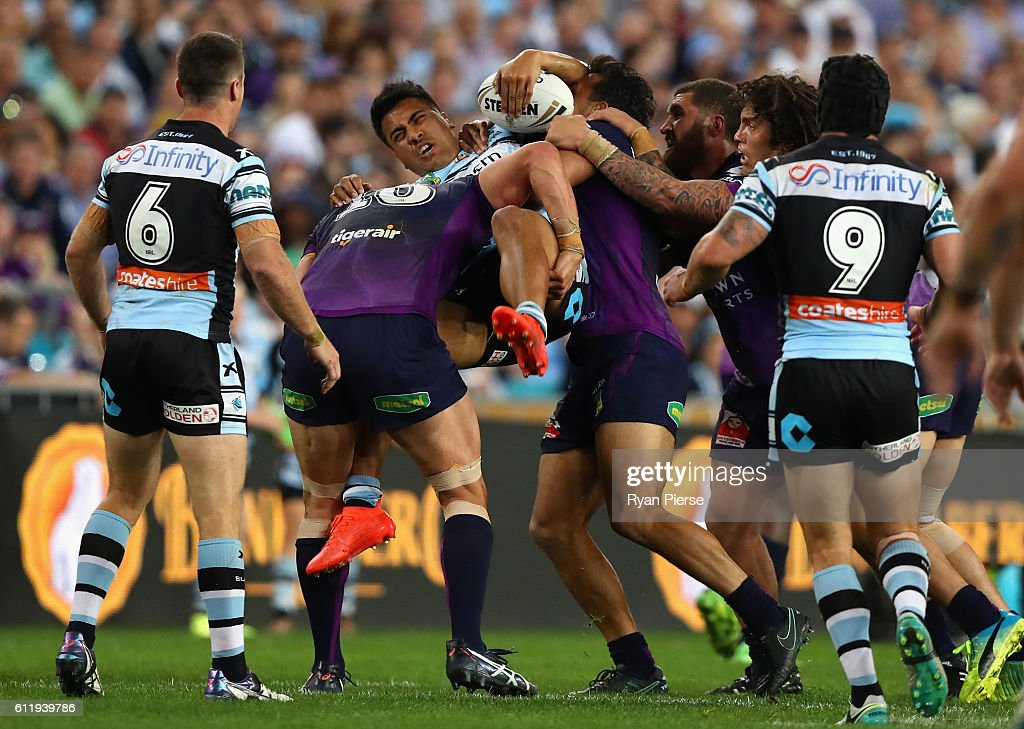 Sosaia Feki of the Sharks is tackled by Jordan McLean and William Chambers of the Storm during the 2016 NRL Grand Final match between the Cronulla Sutherland Sharks and the Melbourne Storm at ANZ Stadium on October 2, 2016 in Sydney, Australia.