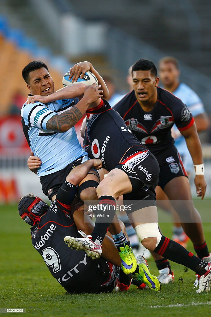 Sosaia Feki of the Sharks is tackled during the round 21 NRL match between the New Zealand Warriors and the Cronulla Sharks at Mt Smart Stadium on August 1, 2015 in Auckland, New Zealand.