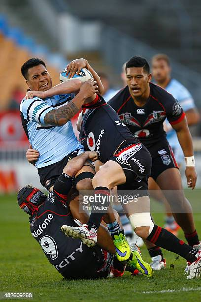 Sosaia Feki of the Sharks is tackled during the round 21 NRL match between the New Zealand Warriors and the Cronulla Sharks at Mt Smart Stadium on...